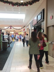 Shoppers walk the halls of Old Hickory Mall on Saturday for after-Christmas shopping.