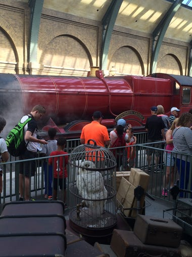 Passengers line up for the Hogwarts Express, which takes them on a short ride to Hogsmeade at Universal Studios Orlando.