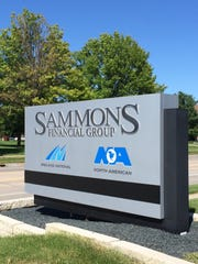 A sign for Sammons Financial Group outsides its West