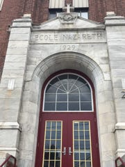 The main entrance to St. Joseph School in Burlington indicates the building's completion date of 1929. Photographed Nov. 30, 2016.