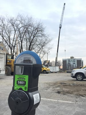 Endangered species: A blue-top, 3-hour parking meter stands outside the entrance to Browns Court parking lot in Burlington on Tuesday. The lot, bought by Champlain College from the city, is now part of a construction zone for the college's Eagles Landing student apartments. Photographed Jan. 10, 2017.