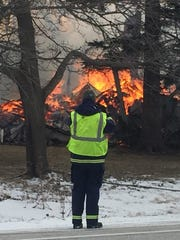 A structure fire was the cause for the closure of U.S. 2 in South Hero. An emergency worker is seen here on Thursday afternoon, Feb. 9, 2017.