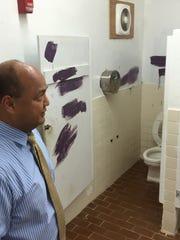 Education Superintendent Jon Fernandez inspects a restroom