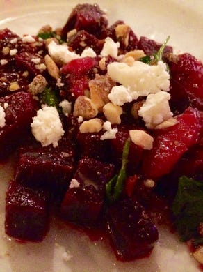 112 Eatery serves a beet and blood orange salad. More traditional favorites (such as a brie-topped cheeseburger) and terrific desserts, such as butterscotch budino, are also available.