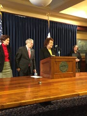 Sheila Lynch speaks at a news conference Monday with Gov. Terry Branstad and Lt. Gov. Kim Reynolds to endorse a bill toughening penalties for repeat offenders in domestic violence cases. Her daughter, TereseAnn Lynch Moore, was killed by her estranged husband in November 2009