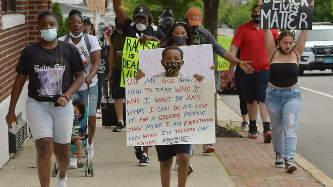 Protesters walk up Shrewsbury Street in Worcester on Wednesday.