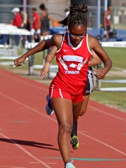 Hirschi's Breonna Campbell crosses the finish line in the 100 meter dash Thursday, March 22, 2018, in the Hirschi Huskies Invitational track meet at Garnett Stadium. Campbell finished in second with a time of 12.73 seconds.