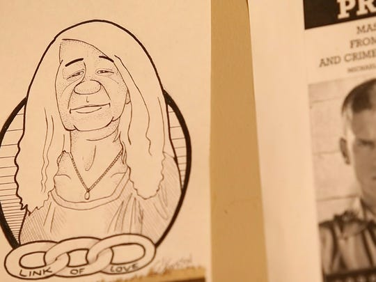 A portrait of Lori Alberts made by an inmate hangs