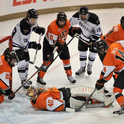 RIT goalie Jordan Ruby (40) lies on the puck during