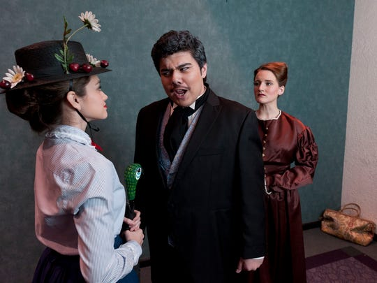 """Casandra Castaneda, left, Vincent Macareno and Lindsey Weeks rehearse for Redwood High School's production of the musical """"Mary Poppins"""" at the L.J. Williams Theater."""