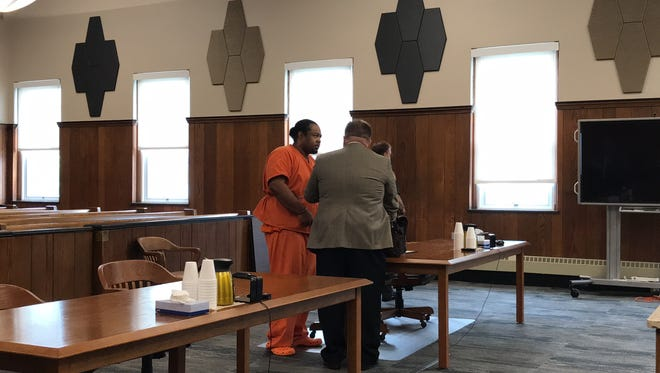 Herman Miller enters Sandusky County Common Pleas Court, shackled and wearing an orange jail jumpsuit, with attorney John Ickes on Wednesday. Miller was sentenced to eight years in prison after being convicted by a jury of rape and kidnapping.
