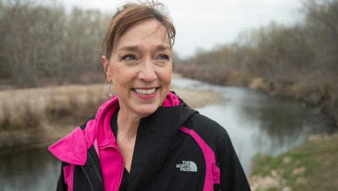 Coloradoan columnist Katy Piotrowski poses for a portrait on her morning walk through Riverbend Ponds Natural Area on Tuesday, April 24, 2018.