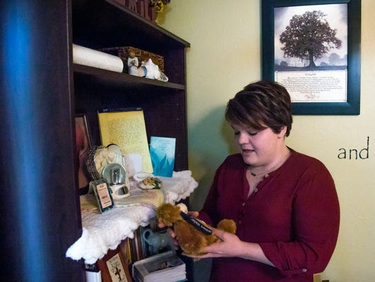 Lindsey Kolpack holds a bear, in her home in Rice Lake,