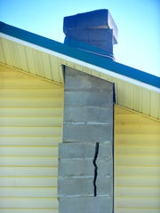 Chimney on the home of Gordon Becker and Hope Quay damaged in the early morning earthquake that struck 5.5 miles south of  Lincoln.