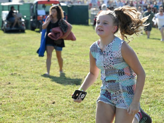 A festival goer runs to get a front-row spot for Justin