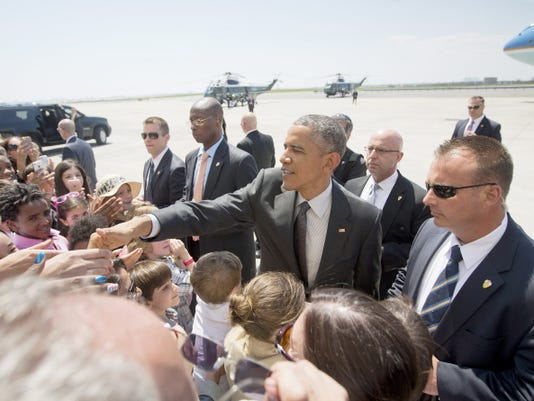 President Barack Obama shakes hands with guests on the tarmac during his arrival at JFK International airport in New York, Monday, May 4, 2015.