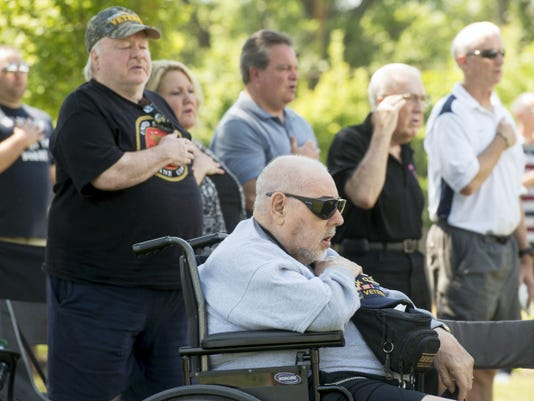 Korean War veteran James Yost, seated, of West Manchester Township at prayer during the Memorial Day Service at Veterans Memorial Park in York on Monday.
