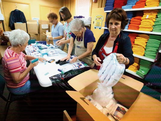 Marylin Ortiz, right, and other volunteers for the Assistance League of El Paso package underwear and other new clothing as part of Operation School Tuesday at their offices at 2728 E. Yandell. The clothing will be distributed in August.