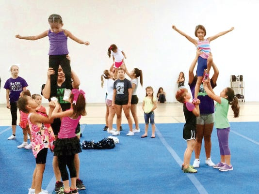 Courtesy Photo   Cheer campers work on stunting during the camp that was hosted by Silver High School.