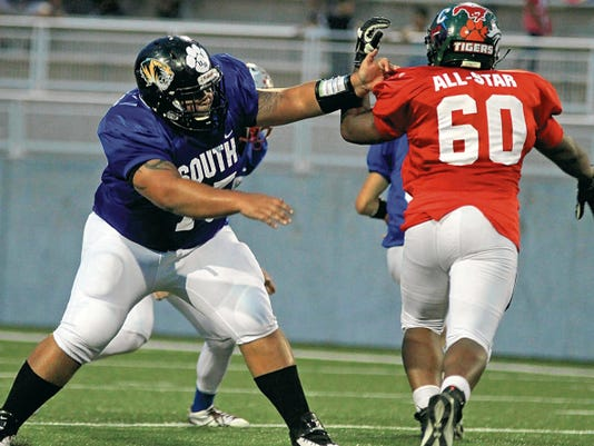 Former Alamogordo offensive lineman Christian Garnand, left, applies pass protection against Adrian Linzy of Rio Rancho during Wednesday's New Mexico High School Coaches Association 5A/6A All-Star Football Game at Community Stadium in Albuquerque. Garnand and teammate William Hooper represented the Tigers on the 29-man South All-Star roster. Alamogordo head coach Dale Hooper also served as the South's head coach.