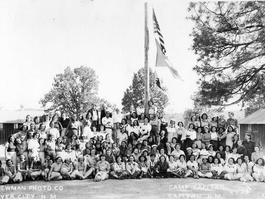 The photograph shows a 1938 group of young women from New Mexico, Arizona and Texas. They were participants of the NYA educational camp located in Baca Canyon, at the turn-off between Lincoln and Capitan.