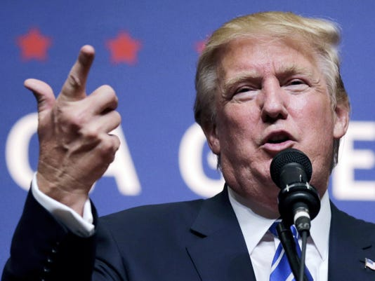 Republican presidential candidate Donald Trump gestures during a campaign stop at Winnacunnet High School in Hampton, N.H., Friday, Aug. 14, 2015. (AP Photo/Charles Krupa)