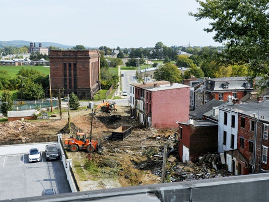 Parts of York's northeast neighborhood are being demolished to make room for more parking for Think Loud's operations at the former Bi-Comp building, as seen from the company's rooftop deck at 210 York St. last week. United Fiber & Data, a separate company with similar stakeholders as Think Loud, will house its office space on the building's second floor, with a data center expected to be built somewhere in the neighborhood. Figuring out exactly where to build the data center is like playing a game of Tetris, said Think Loud CEO Bill Hynes.