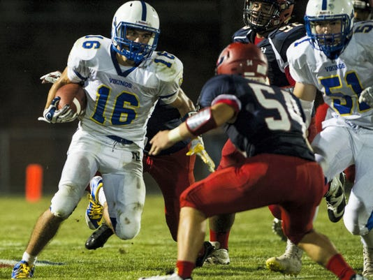 Northern Lebanon's Dylan Weaver looks for running room against Lebanon in Week 2. The Vikings have forfeited their first two wins of the season, including the victory over the Cedars, having used an ineligible player.