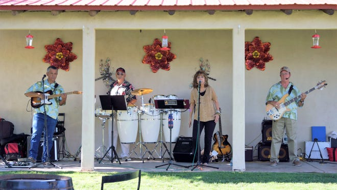 """Triple Play kept a lively beat and the audience entertained during St. Clair Winery's """"Wine and Music"""" every Friday evening this summer."""