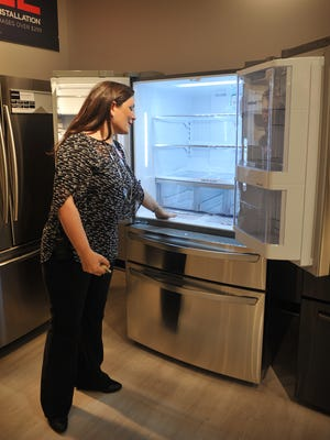 JCPenney general manager Kathleen Lauck talks about the features of an LG refridgerator at her store in Sikes Senter Mall. JCPenney has begun selling home appliances again after more than thirty years. Appliance sales will replace furniture sales at the Wichita Falls location.