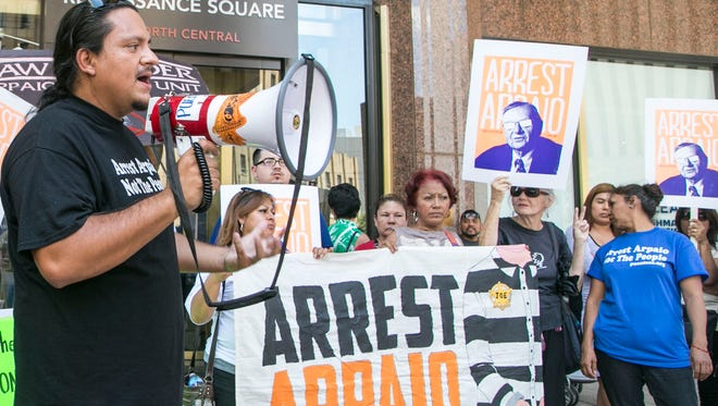 Carlos Garcia of  Arizona-based Puente Human Rights Movement speaks at a protest asking U.S. Attorney John Leonardo to prosecute Maricopa County Sheriff Joe Arpaio on Monday, August 22, 2016, in downtown Phoenix.