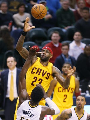 Cleveland Cavaliers forward LeBron James got a little altitude over Indiana Pacers center Roy Hibbert on Feb. 6, 2015.