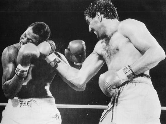 Gerry Cooney (right) lands a right hand against Larry Holmes in their 1982 fight for the heavyweight championship.