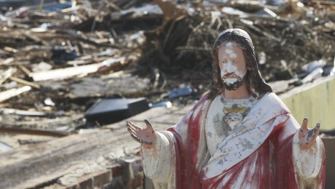 A garden statue of Jesus with outstreched arms sits among the rubble on Brook Avenue in Union Beach in November 2012, after the entire block sustained severe damage from  superstorm  Sandy.
