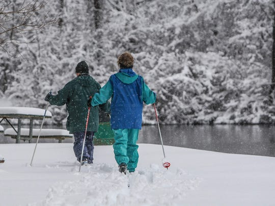 Monday March 25th, 2013, Snow falls on Eagle Creek Park during the first days of spring.  Mimi Brittingham and her husband Bill Rosenbaum cross country ski through Eagle Creek Park on a day they had planned off to take their first golf outing of the season.  (Michelle Pemberton/The Star)