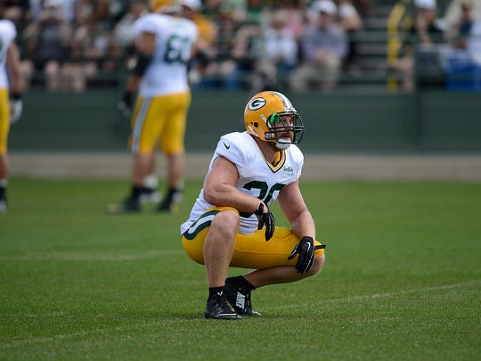 Green Bay Packers fullback John Kuhn looks on during training camp practice at Ray Nitschke Field on Tuesday, Aug. 11, 2015.