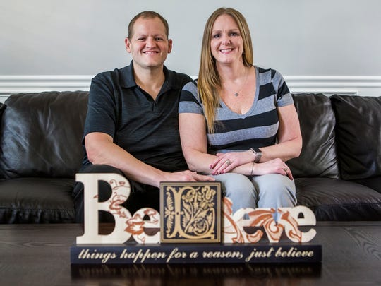 Sean and Janeen Feck pose for a portrait in their home in Wilmington on Monday Tuesday evening.