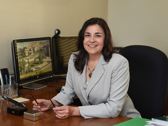 TMCC president Karin Hilgersom sit at her desk on June
