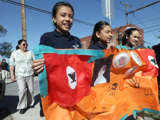 Students from the La Fe Preparatory School take part in a march in honor of Cesar Chavez Friday in South El Paso on the anniversary of his birthday.
