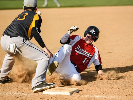 Annville-Cleona's Brad Balmer slides safely into third as Annvllle-Cleona downed Lancaster Mennonite 7-2 on Tuesday, April 11, 2017.