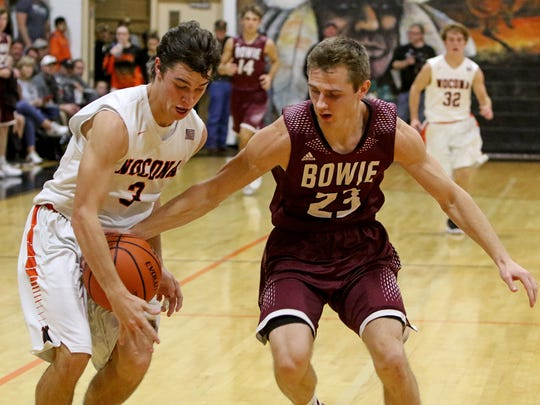 Nocona's Jeremy James attempts to steal the ball from Bowie's Jeffery Howard Tuesday, Dec. 19, 2017, in Nocona.