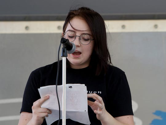 Trinity Kronlein, a student from Rider High School, reads a speech on gun control March for Our Lives rally Saturday, March 24, 2018, on Eighth Street.