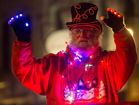 Roy Cobert of Marshfield waves to the parade-goers
