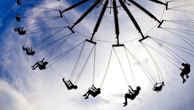 Fairgoers ride the swings at the 2014 Tennessee State Fair on Sept. 6, 2014.