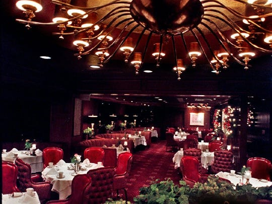 Harrah's Steak House, seen here in 1998, still offers its trademark expanse of red leather and upholstered seating.