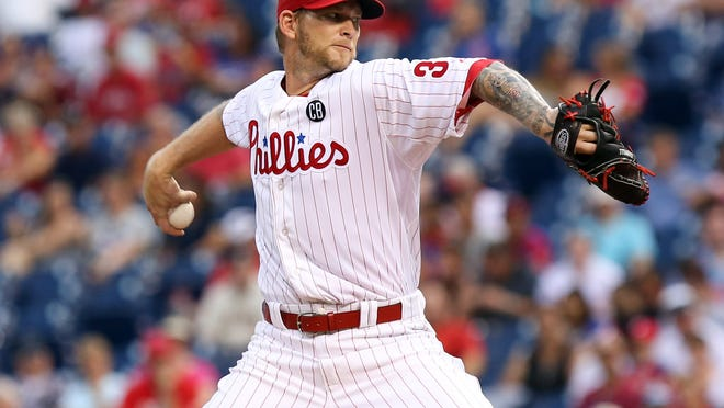 Philadelphia Phillies starting pitcher A.J. Burnett (34) pitches during the first inning of Wednesday's game against the San Francisco Giants at Citizens Bank Park. Credit: Bill Streicher-USA TODAY Sports