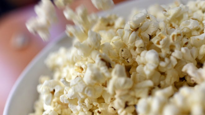 A picture taken on February 10, 2015 in Paris shows a bowl of popcorn.