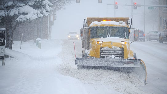 A city of Sioux Falls truck clears 14th Street during