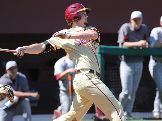Florida State's Gage West follows through after hitting a three-run home run during Sunday's game against Boston College.