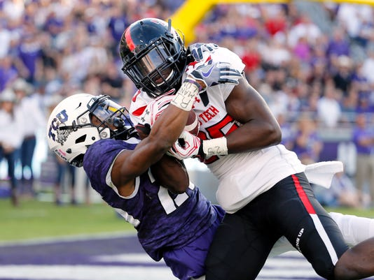 FILE - In this Oct. 29, 2016, file photo, Texas Tech defensive back Douglas Coleman, right, intercepts a pass at the goal line intended for TCU wide receiver KaVontae Turpin during the second half of an NCAA college football game in Fort Worth, Texas. Texas Tech won in double overtime, 27-24.  The teams meet again this week. This time, TCU is trying to stay in position for a potential rematch with Oklahoma in the Big 12 championship game. With questions about coach Kliff Kingsbury's future, Texas Tech (5-5, 2-5) needs another win to get bowl eligible. (AP Photo/Tony Gutierrez, File)